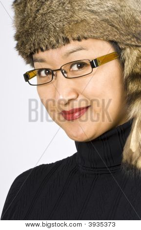 Asian Woman With A Raccoon Hat