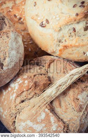 Fresh Baked Crunchy Wholegrain Rolls For Breakfast And Ears Of Rye Or Wheat Grain