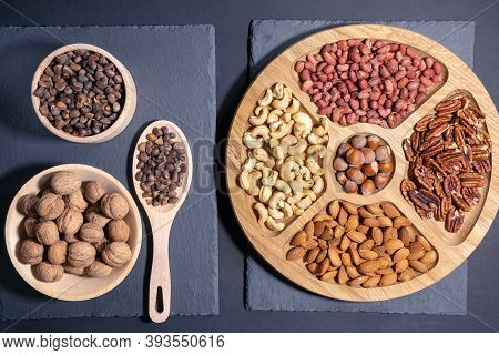 Mixed Nuts On A Dark Background. Healthy Food And Snacks. Pecans, Cashews, Almonds, Peanuts, Pine Nu