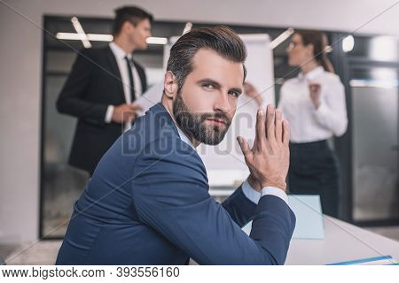 Young Bearded Man Sitting In Office After Presentation