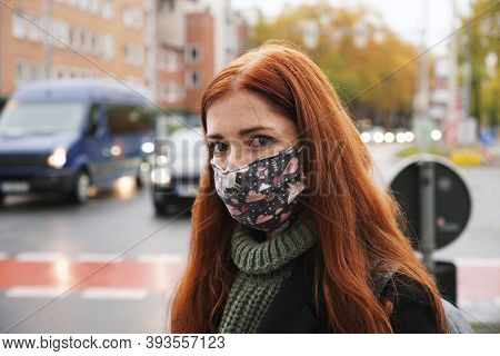 Young Woman Wearing Everyday Cloth Face Mask Outdoors As Pedestrian In Busy City Traffic, New Normal