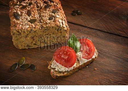 Tomatoes, Basil And Cream Cheese On Homemade Protein Bread From Lupine Flour, Oat Bran And Pumpkin S