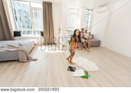 8 Years Old Girl Jumping In A Child Room At Home, Still Life Photo