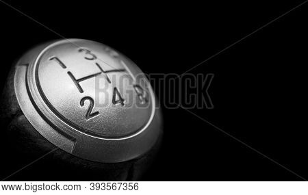 Close Up View Of A Manual Gear Lever Shift Isolated On Black Background. Manual Gearbox. Car Interio