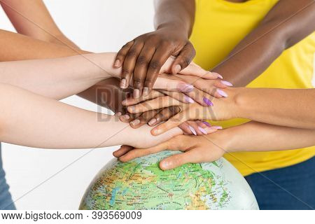 Colorful Hands. Hands On The Globe. Different Races Of People. One Team Called Humanity. Racial Tole