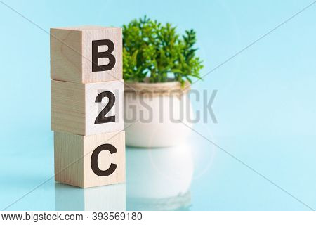 Letter Of The Alphabet Of B2c On A Light Blu Background. B2c - Business-to-consumer