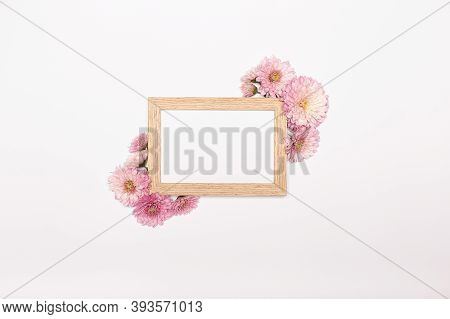 Flowers Composition. Photo Frame, Chrysanthemum Flowers On White Background. Spring Concept, Flat La
