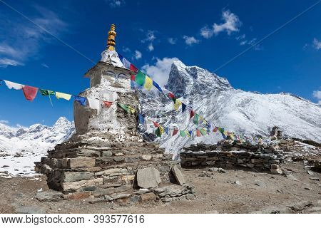 Buddhist Prayer Flags On A Buddhist Chorten On Everest Base Camp Route In Himalayas, Nepal. Fine Pho