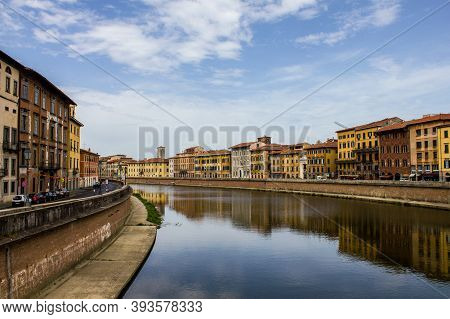 Pisa, Italy - July 9, 2017: View Of Traditional Colorful Buildings Along Arno River On A Summer Day