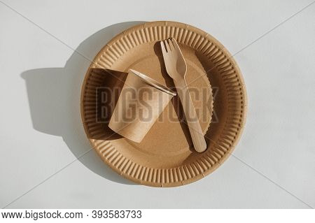 Set Of Disposable Tableware Cup, Kraft Paper Plate And Wooden Fork On A White Background. Eco Kraft