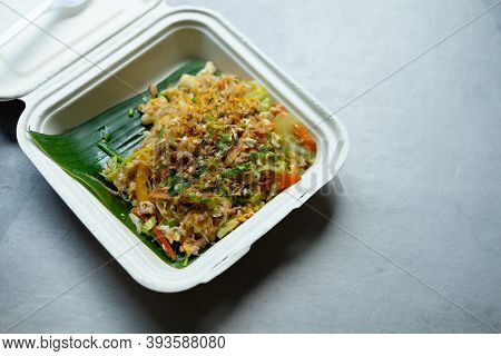 Stir Fry Glass Noodle With Minced Pork And Egg In Unbleached Plant Fiber Food Box. Thai Homemade Foo