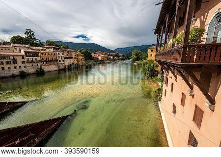 The River Brenta View From The Bridge Of The Alpini (ponte Degli Alpini Or Ponte Vecchio) In Bassano