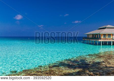 Beautiful summer beach paradise with sandy beach and villas and lagoon