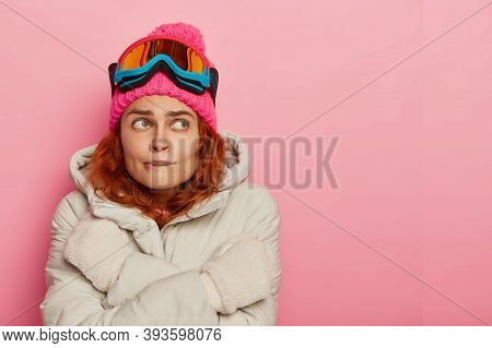 Girl Skier Feels Cold, Trembles And Bites Lips, Wears Warm Winter Outerwear, Has Active Recreation D