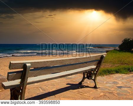 A Lonely Bench By The Sea At Sunset - Loneliness