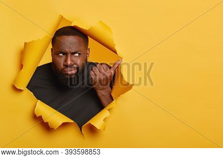 Now Way, Bad Choice. Photo Of Frustrated Unhappy Black Man Smirks Face, Points Away With Unimpressed