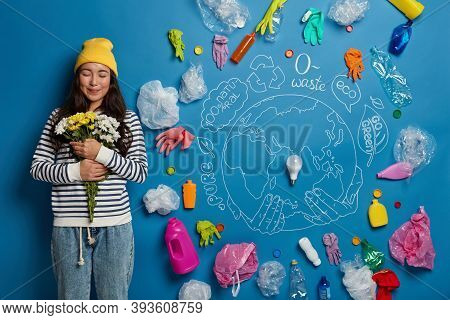 Pleased Korean Woman Satisfied To Get Bouquet, Holds White And Yellow Flowers, Stands Against Drawn