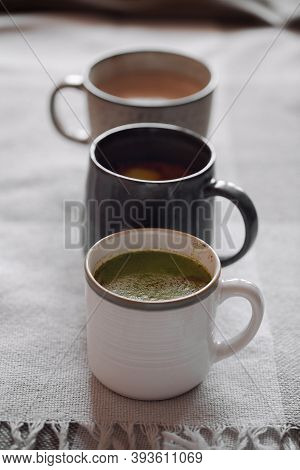 Three Cup Of Cocoa With Coconut Milk. Concept Of Cosy Winter Holidays Drink