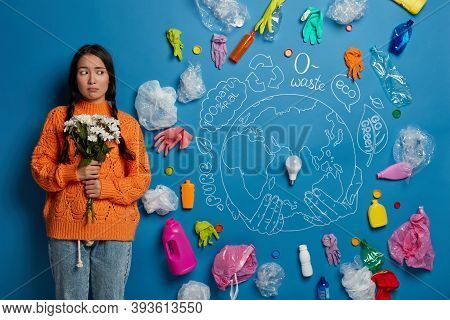 Sad Disappointed Nature Preserver Stands With Bouquet Against Blue Background With Drawn Planet And