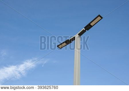 A Metal Design Lamppost Against A Clear Blue Sky Background