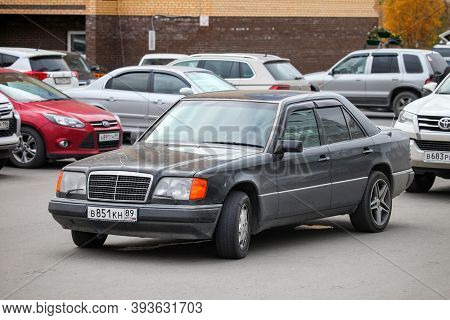 Novyy Urengoy, Russia - September 13, 2020: Black Saloon Car Mercedes-benz E-class (w124) In The Cit