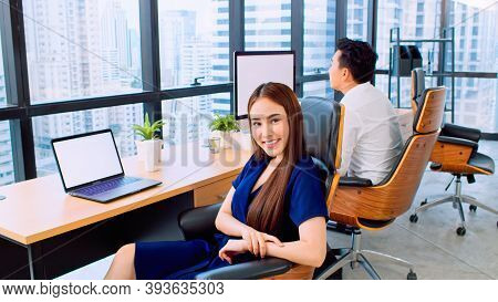 Portrait Of Happy Asian Businesswoman Sit And Smile In Startup Company Office, Business Coworker Wor