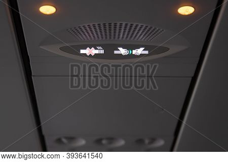 Smoking And Seat Belt In A Airplane Plane Ceiling Interior