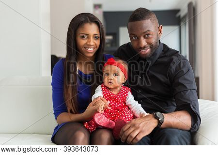 Portrait Of A Young African American  Couple With Her Baby Girl