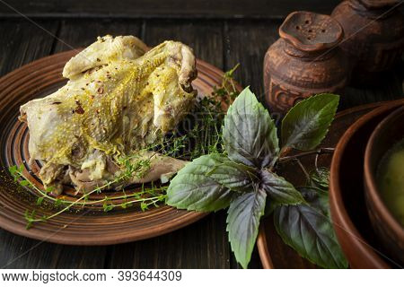Roast Wild Partridge Plated Meal On Rustic Table And Brown Plate