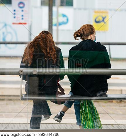 Strasbourg, France - Oct 18, 2020: Square Image Of Rear View Of Two Young Girls With Protection Surg