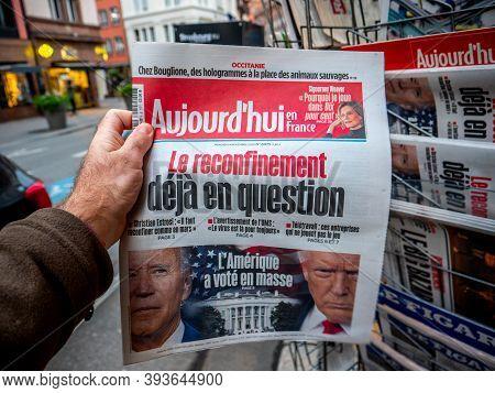 Paris, France - Nov 5, 2020: Pov Male At Press Kiosk With Aujordhui Newspaper Featuring On Cover Pag