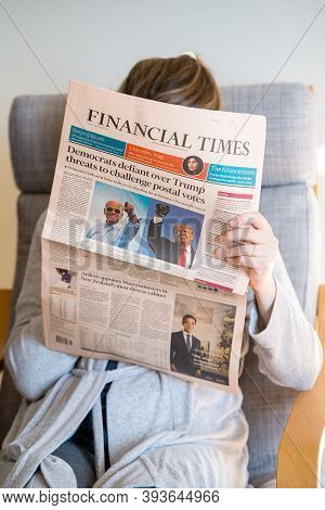 Paris, France - Nov 5, 2020: Woman Reading In Living Room The Latest Business Financial Times Newspa