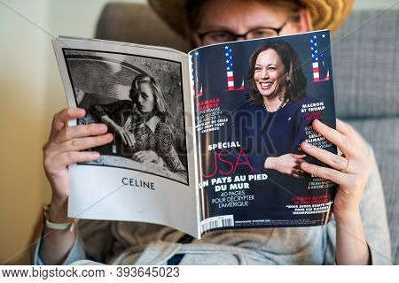 Paris, France - Nov 5, 2020: Woman Reading In Living Room The Latest Elle Magazine Featuring On Cove
