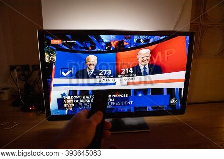 Paris, France - Nov 7, 2020: Pov Man In Living Room Watching Tv Featuring Latest News That Democrati