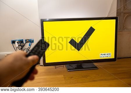 Paris, France - Nov 7, 2020: Living Room Tv On The Wooden Floor Featuring Latest News That Democrati