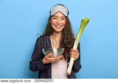 People, Wellness And Healthy Eating Concept. Happy Mixed Race Woman Holds Raw Green Leek, Returns Fr