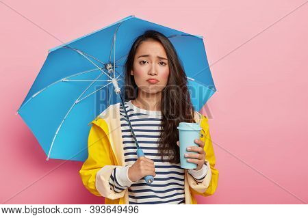 Portrait Of Dejected Woman With Korean Appearance, Feels Sad Because Of Bad Weather, Forecast Wasnt