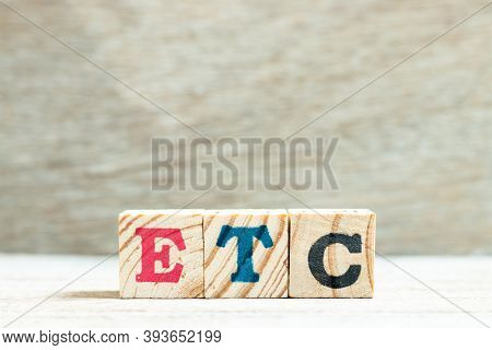 Alphabet Letter In Word Etc (abbreviation Of Et Cetera) On Wood Background