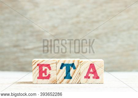 Alphabet Letter In Word Eta (abbreviation Of Estimated Time Of Arrival) On Wood Background
