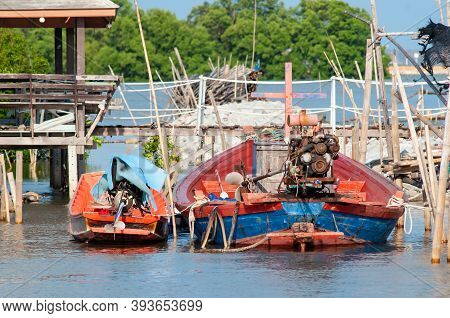 Traditional Longtail Boats At The Port Of Samae Khao, A Fishing Village On The Coast Of The Gulf Of