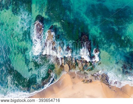 Top Down View Of Rocks And Waves At Dudley Beach In Newcastle Australia