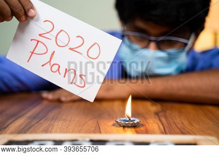 Sad Frustrated Man In Medical Mask Burning 2020 Plans - Concept Of Failed 2020 Plans Due To Covid-19