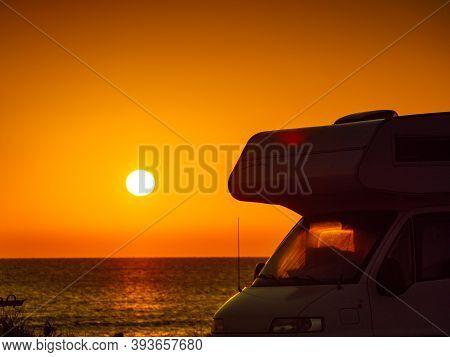 Camper Recreational Vehicle At Sunrise On Mediterranean Coast In Spain. Camping On Nature Beach. Vac
