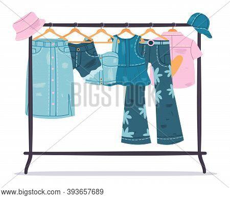 Denim Clothing. Jeans Garments Hanging On Hanger, Trendy Casual Cotton Apparel. Stylish Denim Wardro