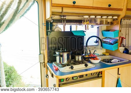 Caravan Rv Inside, Kitchen Area. Cooking In Campervan. Holidays, Adventure With Motor Home. Van Life