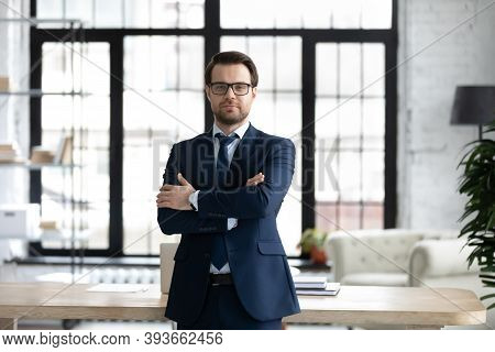 Portrait Of Pleasant Young 30s Male Ceo Executive Manager.