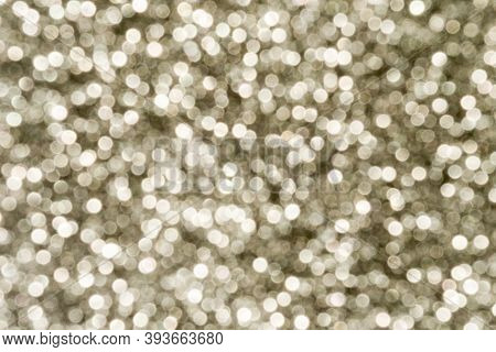Silver Sparkling Lights Festive Background With Texture. Abstract Christmas Twinkled Bright Bokeh De
