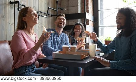 Group Of Loyal Clients Of Italian Restaurant Enjoying Tasty Pizza