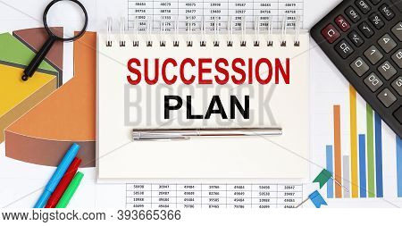 Notepad With Text Succession Plan On The Business Charts And Pen