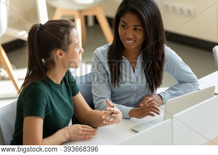 Millennial Woman Intern Asking Experienced Biracial Female Colleague For Advice